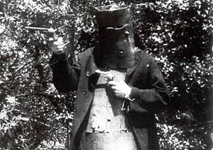 The Story of the Kelly Gang - Actor portraying Ned Kelly in an authentic suit of the Kelly gang's armour, which was loaned to the filmmakers and used in the film.
