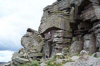 Stanage Edge - Climbers on The Tippler (graded E1 5b)