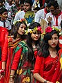 Three Bangladeshi girls wearing draping sari with flower crown at Pohela Boishakh celebration 2016 (01).jpg