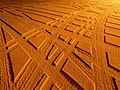 Tire tracks in snow under sodium light 3.jpg