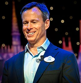 Tom Staggs on stage at the Disney Social Media Moms Conference (13782189034) (cropped).jpg