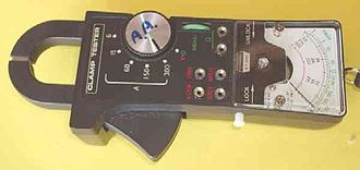 Electronic test equipment - A multimeter with a built in clamp facility. Pushing the large button at the bottom opens the lower jaw of the clamp, allowing the clamp to be placed around a conductor (wire). Depending on sensor, some can measure both AC and DC current.