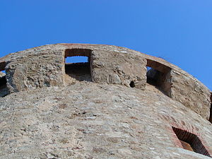 Genoese towers in Corsica - Torra di Capiteddu: detail showing the machicolations