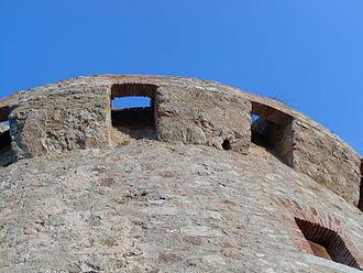 Genoese towers in Corsica - Torra di Capiteddu: detail showing the machicolations
