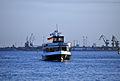 Touristenfähre auf der Warnow mit Hafengelände im Hintergrund.jpg