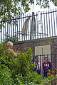 Tourists taking pictures below Prime Merdian monument at Greenwich Observatory, London.jpg