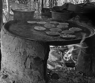 Pupusa - Traditional pupusas in El Salvador are cooked over wood fire, using a pottery griddle (called a comal).