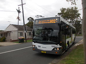 Transit Systems Sydney - Custom Coaches CB60 Evo II bodied Volvo B12BLE still in Hopkinsons livery near Woodpark T-way in April 2014