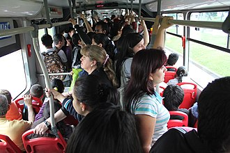 TransMilenio vehicles carry up to 270 people. Transmilenio vehicle interior.jpg