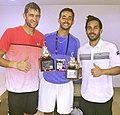 Treat Huey with his Coach Othmane Garma and doubles partner Max Mirnyi after winning the Mexican Open 2016.jpg