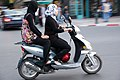 Two females riding Kymco scooter in Marrakech (4593194590).jpg