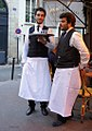 Two waiters, rue de Seine, Paris 26 July 2013.jpg