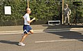 U.S. Air Force Master Sgt. Lawrence W. Hagdorn, with the 100th Comptroller Squadron, sprints out the last few yards of the Team Mildenhall 5-kilometer run at Royal Air Force Mildenhall, United Kingdom, Aug. 10 120810-F-UA979-023.jpg