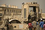U.S. Air Force Staff Sgt. Jacob Snellings, top right, a pavements and construction equipment specialist assigned to the 577th Expeditionary Prime Base Engineer Emergency Force Squadron, climbs into a vibratory 130613-F-YL744-211.jpg
