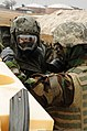 U.S. Air Force Staff Sgt. Joseph Vawter, left, and Airman Basic Clarence Jones, patrolmen with the 28th Security Forces Squadron, don chemical and biological warfare personal protective equipment during a Phase 100303-F-VO466-087.jpg