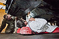U.S. Army Pfc. Eric Grzegorczyk, from Pittsburgh, Pa., a mechanic with the maintenance platoon of Headquarters and Headquarters Company, 3rd Battalion, 509th Infantry Regiment, Task Force Spartan, supervises 120219-A-ZU930-005.jpg