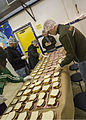 U.S. Marines, assigned to Marine Forces Reserve (MARFORRES), prepare sandwiches during a volunteer event at the Ozanam Homeless Shelter, New Orleans, La., Nov. 25, 2013 131125-M-IJ438-054.jpg