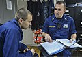 U.S. Navy Chief Engineman Eugene Kodolitsch, right, provides Religious Program Specialist Seaman Daniel Tomaso training on maintenance and material management aboard the guided missile cruiser USS Monterey (CG 130513-N-QL471-079.jpg