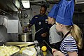 U.S. Navy Culinary Specialist 2nd Class Pelham Vancooten teaches family members how to bake an apple pie during a dependents' day cruise aboard the aircraft carrier USS John C. Stennis (CVN 74) in the Pacific 130426-N-ZB122-076.jpg