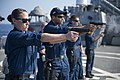 U.S. Navy Master-at-Arms 1st Class Krystal Meza, left, and Gunner's Mate 2nd Class Gregory Spaulding fire 9 mm pistols during a small-arms qualification aboard the guided missile destroyer USS Stout (DDG 55) 140118-N-UD469-492.jpg