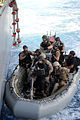 U.S. Sailors and Marines with the visit, board, search and seizure team, currently assigned to the guided missile cruiser USS San Jacinto (CG 56), complete loading of a rigid-hull inflatable boat in preparation 100524-N-EF447-013.jpg