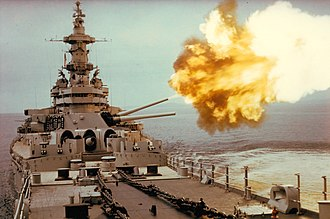 USS Iowa (BB-61) - USS Iowa fires a 16 in (406mm) shell towards a North Korean target in 1952.