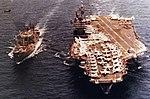USS Rigel (AF-58) replenishes USS John F. Kennedy (CVA-67), in the early 1970s.jpg