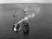 USS Yorktown (CVA-10) and a destroyer being refueled, circa in 1953 (80-G-632007)
