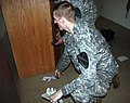 "US Army 51811 Spc. Jesse Barlow, assigned to the 2nd Battalion, 12th Cavalry Regiment, 4th Brigade Combat Team, 1st Cavalry Division ""Long Knives,"" and native of Elizabethtown, Ky., locates sensitive materials insi.jpg"