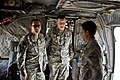 US Army 53163 CAMP TAJI, Iraq-During a return trip to Iraq as a part of Operation Proper Exit, Sgt. John Hyland (left) and Sgt. 1st Class Joshua Olson (center), get a tour of a CH-47F Chinook helicopter by Josia Or.jpg
