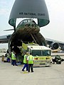 US Navy 020731-N-9643K-010 Naples Fire Rescue Team load their Fire Truck on a C-5A.jpg