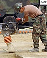 US Navy 030227-N-4843P-009 Steelworker Constructionman Peter Blum uses a wack-packer to pack dirt.jpg