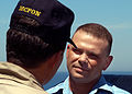 US Navy 030418-N-4048T-050 Master Chief Petty Officer of the Navy (MCPON) Terry Scott takes a moment to talk with Boatswain's Mate 1st Class Kim Tate.jpg