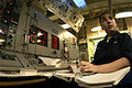 US Navy 030910-N-1671M-018 Electrician's Mate 3rd Class Jessica Ruthart from Lehigh, Iowa, listens to an explanation.jpg