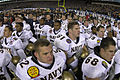 US Navy 031206-N-0399H-528 U.S. Naval Academy Midshipmen gather with West Point Cadets following the conclusion of the 104th meeting of Army and Navy to sing each schools alma mater.jpg