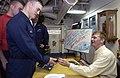 US Navy 031210-N-5319A-003 NASCAR driver Jeff Burton signed autographs on the mess decks aboard USS George Washington (CVN 73).jpg