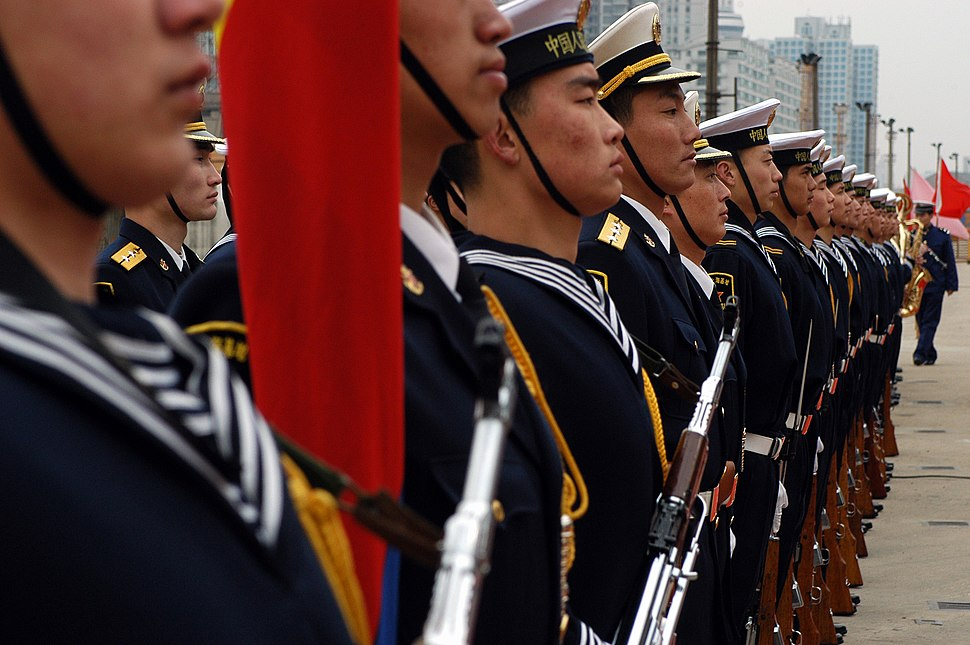 US Navy 040224-N-4055P-002 People%27s Liberation Army (Navy) sailors stand in formation on Gaoyang Road pier during the arrival of the Seventh Fleet command ship