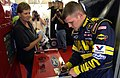 US Navy 040401-N-5862D-136 Casey Atwood signs an autograph at the Texas Motor Speedway before qualifying in the time trials for the O'Reilly 300 NASCAR Busch Series competition.jpg