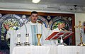 US Navy 040913-N-7232R-006 Cmdr. Michael Parisi of Paterson, N.J., conducts mid-day Catholic Mass in the ship's chapel for the crew members aboard the Nimitz-class aircraft carrier USS John C. Stennis (CVN 74).jpg