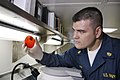 US Navy 050624-N-3136P-012 Chief Hospital Corpsman Charles Hickey from San Diego, Calif., examines a culture dish aboard the conventionally powered aircraft carrier USS Kitty Hawk (CV 63).jpg