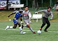US Navy 051016-N-9860Y-539 U.S. Navy Machinist's Mate 2nd Class Samuel Nah, left, chases down the ball during an all-star game that wrapped up an international soccer tournament.jpg