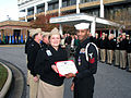 US Navy 051216-N-6430T-015 Director of the Navy Nurse Corps, Rear Adm. Christine M. Bruzek-Kohler presents Hospital Corpsman 1st Class Dexter Lewis with the Purple Heart Medal and citation.jpg