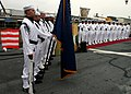 US Navy 060602-N-4953E-002 Members of guided-missile destroyer USS Stethem (DDG 63) Flag Detail stands at attention along with Chief Petty Officers during a retirement ceremony in honor of Chief Gas Turbine Systems Technician T.jpg