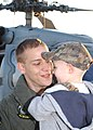 US Navy 061117-N-8544C-032 Aviation Structural Mechanic 2nd Class Matthew Castleberry embraces his son on the pier during the homecoming of Helicopter Antisubmarine Squadron One One (HS-11).jpg