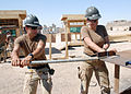 US Navy 070620-N-3560G-054 Steelworker Constructionman Siamac Moghaddam and Builder Constructionman Teresa Ruiz, of Naval Mobile Construction Battalion (NMCB) 4, shape steel supports to be used on various construction projects.jpg