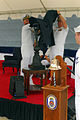 US Navy 070822-N-1688B-052 Adm. Gary Roughead, commander of U.S. Fleet Forces Command, and Cmdr. John Beaver Jr., commanding officer of guided-missile destroyer USS Bulkeley (DDG 84), unveil the USS Arizona Memorial Trophy.jpg