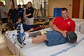 US Navy 071012-N-5086M-014 Coast Guard Fireman Brice A. Brokaw uses the medicine ball for abdominal training during therapy in the new Comprehensive Combat and Complex Casualty Care (C5) facility at Naval Medical Center San Die.jpg
