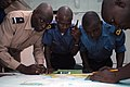 US Navy 071112-N-0193M-082 Military members from Senegal, Ghana and Nigeria work together to plot out small boat movements during a training exercise lead by the U.S. Coast Guard International Training Division aboard amphibiou.jpg