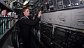 US Navy 090112-N-7705S-081 Machinist's Mate 3rd Class Michael Petersohn, from Tacoma, Wash., checks the controls after demonstrating the pressurization of a torpedo tube aboard the Los Angeles-class fast-attack submarine USS Bo.jpg