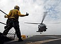 US Navy 090123-N-6278K-293 Aviation Boatswain's Mate (Handling) 1st Class Jaime Valencia directs the landing of an HH-60H Sea Hawk helicopter.jpg